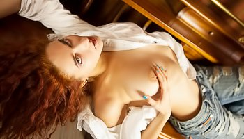 Redhead princess is touching herself