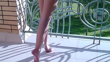 Elegant blonde is getting naked on camera