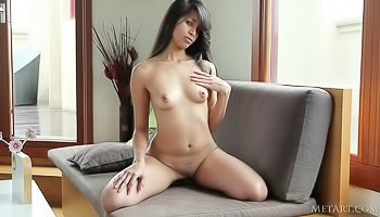 Sensual brunette is enjoying tender solo