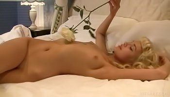 Cute blonde is satisfying herself gently