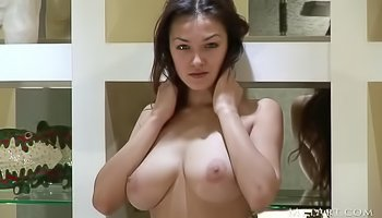 Big-tittied brunette is showing solo skills
