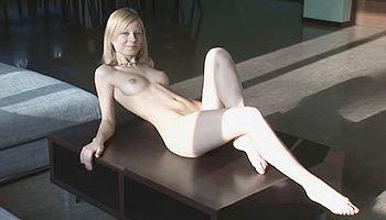 Gorgeous blonde taking everything off