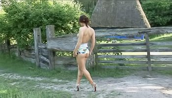 Lovely babe is having solo outdoors