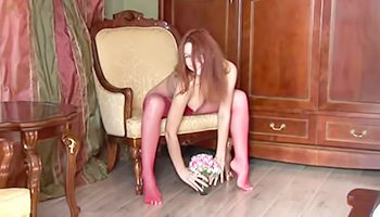 Superb redhead in pink stockings