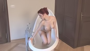 Tender girl is masturbating in bathtub