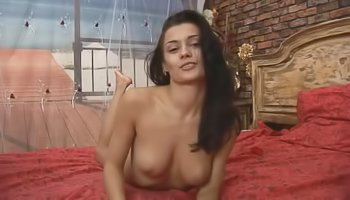 Brunette in red stockings is having solo