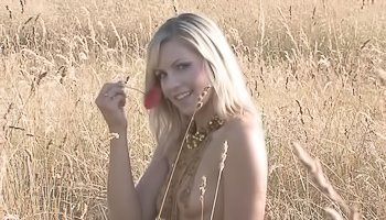 Sensual blonde is having solo in field
