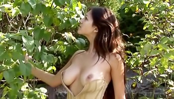 Horny brunette is enjoying solo outdoor