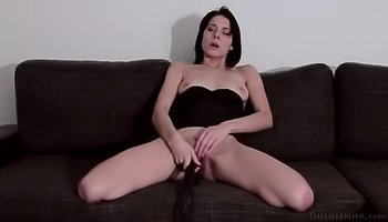 Babe in black is torturing her pussy