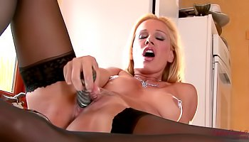Kinky blonde is masturbating wildly