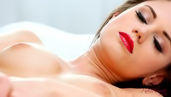 Brunette with red lips is masturbating