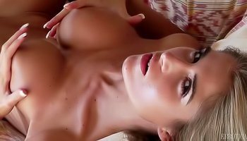Horny blonde is satisfying herself in bed