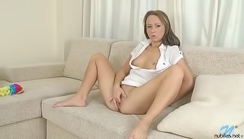 Hot brunette is touching herself wildly