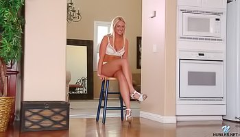 Blonde in white lingerie is enjoying solo