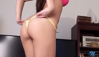 Sweet brunette is masturbating on the floor