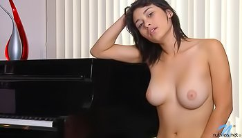 Babe is masturbating on the piano