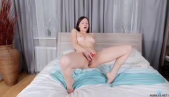 Wild brunette is dildoing her shaved pussy