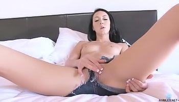 Brunette in jeans shorts is masturbating