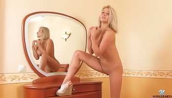 Horny blonde is practicing solo