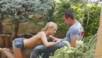 Young blonde is getting penetrated outdoors