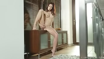 Sensual girl is fingering her shaved pussy