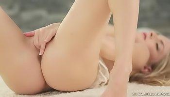 Petite blonde is masturbatin gently