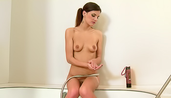 Join the brunette taking shower alone