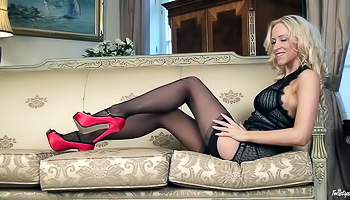 Hot blonde in stockings is masturbating