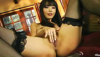 Fishnets-clad Asian gets to finger her pussy