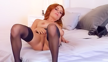 Redheaded beauty teasing her pussy