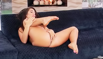 Busty brunette by the fire