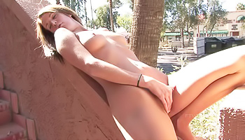 Busty brunette cums hard outdoors