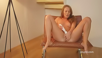 Redhead in black masturbating for you