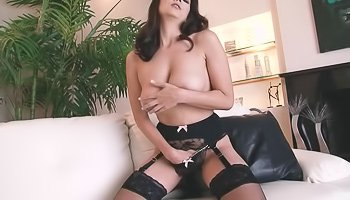 Brunette in stockings teasing herself