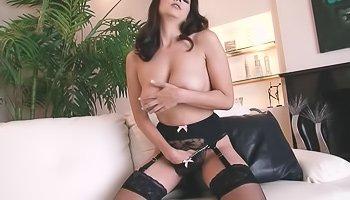 Brunette in stockings teasing herself