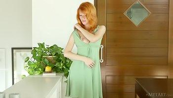 Lustful redhead madam is touching herself