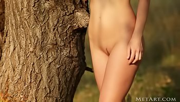 Cute babe is getting naked outdoors