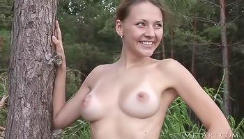 Busty girl is enjoying solo outdoors