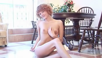 Curly babe is enjoying passionate solo