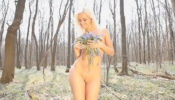 Kinky blonde is stripteasing outdoors