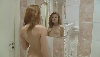 Naked blonde is masturbating in bathroom