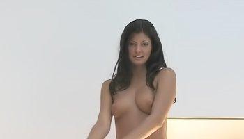 Kinky brunette is touching her body