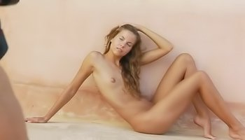 Tender chick is enjoying erotic photosession