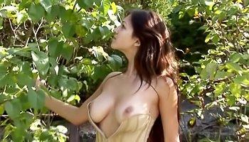 Horny brunette is enjoying solo outdoor