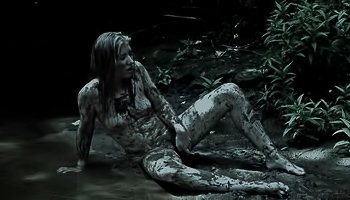 Brunette is having solo in the mud