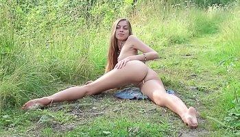 Skinny babe is enjoying solo outdoors