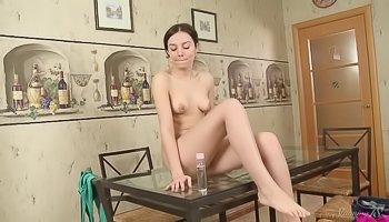 Brunette babe is fingering her pussy