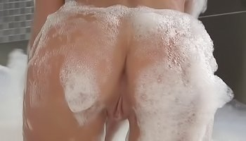 Naked babe is taking shower alone