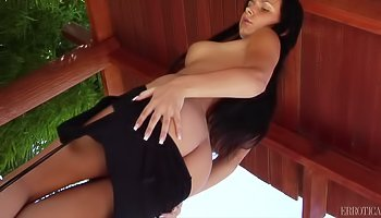 Sexy brunette is touching herself