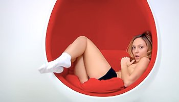 Skinny babe in a sexy egg chair